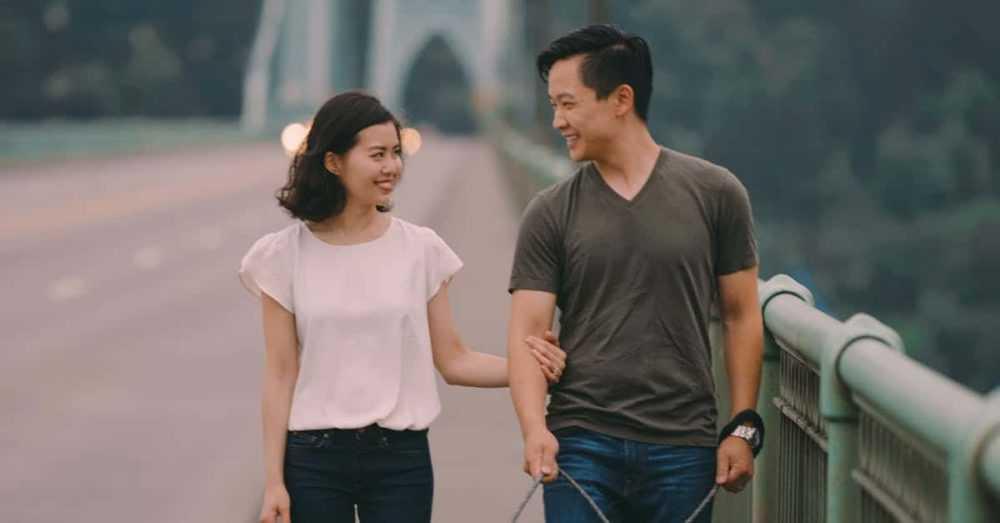A man standing next to a woman