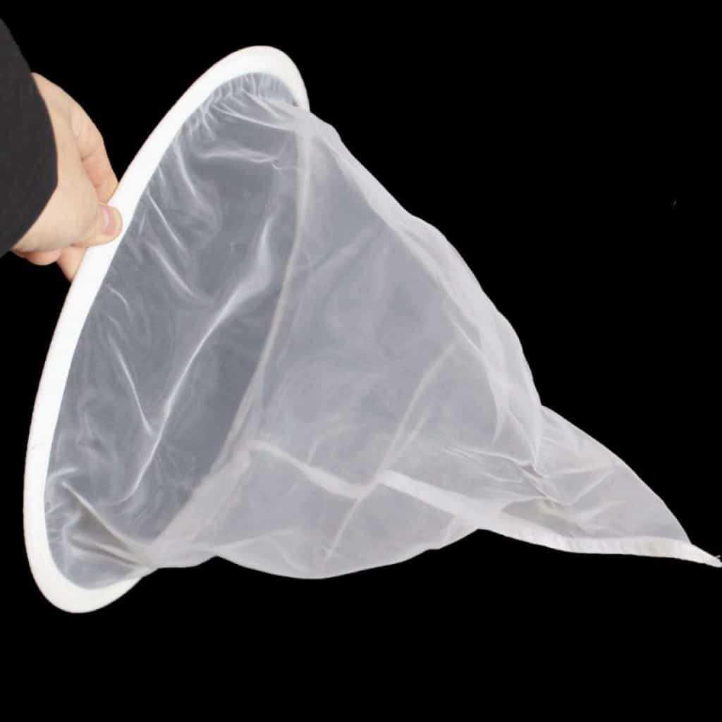 A hand holding a bag